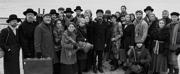 Photo: Yiddish FIDDLER Cast Poses in Front of Ellis Island