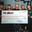 Dolores O'Riordan's Children Presented with $250,000 Check by Bad Wolves Photo