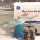 VIDEO: Man Dressed as Elsa Pushes Police Wagon Stuck in Snow