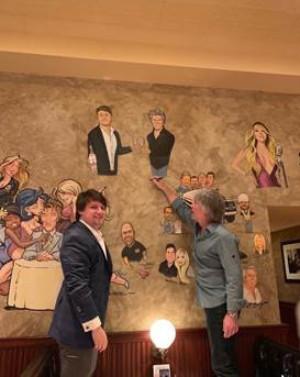 Jon Bon Jovi Signs Caricature At The Palm In Las Vegas