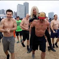 VIDEO: Lady Gaga, Taylor Kinney Take Polar Plunge for Special Olympics Charity Event