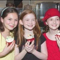 Photo Coverage: ANNIE Cast Tastes Magnolia Bakery's Themed Cupcake
