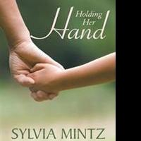 Sylvia Mintz Releases HOLDING HER HAND