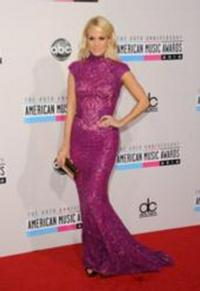 Carrie Underwood Carries Jill Milan Handbags to American Music Awards