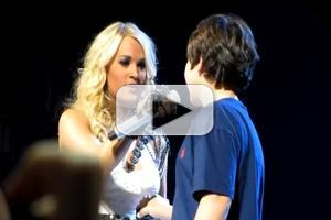 VIDEO: Viral Video - Carrie Underwood Gives 12 Year Old Fan 'First Kiss' in Concert