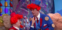 VIDEO: Liam Neeson and Stephen Colbert Star in Candy Crush: The Movie!