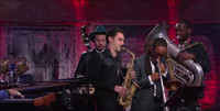 VIDEO: Jon Batiste & Stay Human Perform The French National Anthem on COLBERT