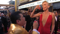 VIDEO: JIMMY KIMMEL's Guillermo Does Shots with Charlize Theron & More on OSCAR Red Carpet!