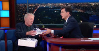VIDEO: Nike Chair Phil Knight Presents Stephen Colbert with His Own 'Col-Pair' Sneakers