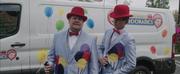 VIDEO: Watch James Corden & Eddie Redmayne Deliver Singing Telegrams