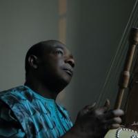 Toumani Diabaté & the London Symphony Orchestra Debut New Track 'Elyne Road' Photo