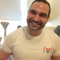 Behind the Rainbow Flag: Javier Munoz Shares a Happy Memory of His First Pride Parade Photo