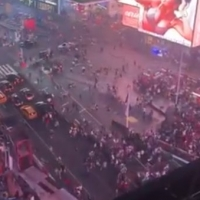 Social: Thousands Flee As Motorcycle Backfire Causes Panic In Times Square Photo