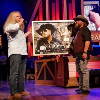 Jamey Johnson Surprises Colt Ford at the Grand Ole Opry with RIAA Award