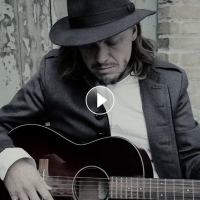 John Garrison Shares New Video For 'The Revolution Is Just Waiting A Name' Photo