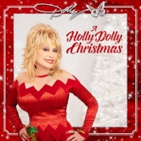 Dolly Parton Releases Her Whimsical Take on 'I Saw Mommy Kissing Santa Claus' Photo