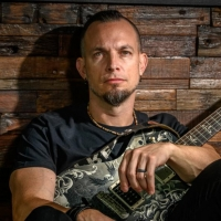 VIDEO: Tremonti Releases Live Music Video For 'A World Away' Photo