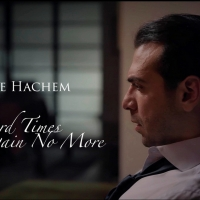 Watch: Tenor Amine Hachem Releases New Single and Music Video 'Hard Times Come Again  Photo