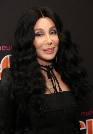 Cher's Coat and Shoes, Dolly Parton's Dress, Hugh Jackman's Wolverine Jacket & More to be Auctioned Off at 'Stage & Screen'