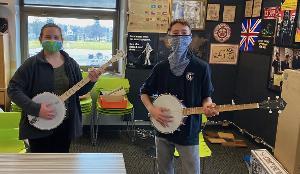 Joe Mullins and Adam McIntosh Present Instruments to Ohio School