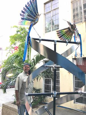 Bernard Stanley Hoyes Delivers Symbolic Spiral Steel Sculpture To Jamaica During The Pandemic