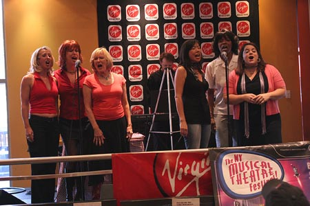 The cast of Expiring Minds, singing 'Welcome to the World of Expiring Minds' (l to r) Leisa Mather, Valerie Fagan, Joy Franz, Pearl Sun, Cheryl Alexander, and Amorika Amorosa  at NYMF Preview - The Unknown, 6 Women With Brain Death, The View From Here and Isabelle and the Pretty-Ugly Spell