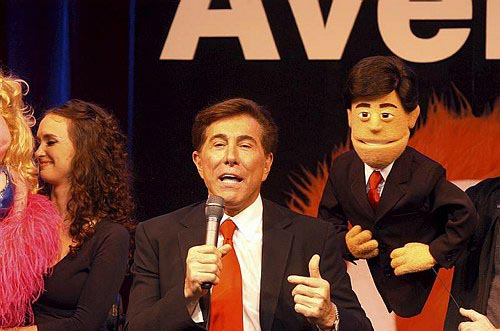 Steve Wynn poses with his puppet