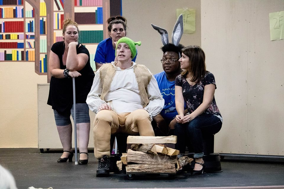 1. Shrek (Steven Dow) pleads with Fiona (Candice Castro,) while Lord Farquaad (Josè Bernard) and two of his men (Amire Collins and Dustin McHale) look on 2