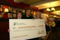 Martha Clarke, Jim Nicola and Heather Randall with the check (as Tony Randall's Sardi's portrait looks on)