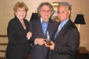 Drama Desk President William Wolf (center) presents the Workshop's special award to BMI's Jean Banks and Del Bryant