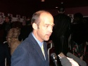 Anthony Edwards stops to talk to the press Photo