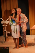 """""""Life is a Coconut"""" sings Wood (Terrence Mann) to his lovely young wife Volere (Karen Photo"""