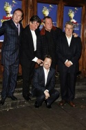 Monty Python's Eric Idle, Michael Palin, Terry Gilliam and Terry Jones with comedian Eddie Izzard