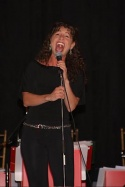 Jodie Langel belting one out to the audience Photo