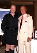 The ever-kilted Jamie and Special Guest Pat Boone pose for a picture.