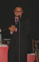 Connie and Carla's Alec Mapa amuses the crowd with a comic monologue all about growing up as a gay Asian who loves musical theatre.