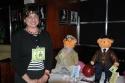 Rosi Zingales with Frankie Valli, Jersey Boys Bear, 2006 -$4,250 and Jiminy Glick Bear, Martin Short: Fame Becomes Me, 2006 - $800