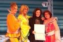 Vicki Van Tassel, Carol Linnea Johnson and Robin Baxter are presented with senatorial certificate