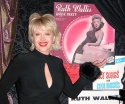Gennifer posing in front of Ruth Wallis' album covers.