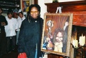 Whoopi posing with the painting  Photo