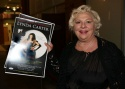 Renee Taylor arrives with poster in hand