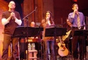 Adam Pascal, Lea Michele and Greg Naughton toward the end of the show, with musician Bobby Baxmeyer behind them.