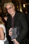 Book Writer Jeffrey Lane with a stack of free CDs
