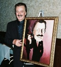 Robert Goulet posing with the newest addition to restaurant's Broadway Wall of Fame Photo