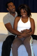 Norm Lewis (Nick) and LaChanze (Pam), a thirty something couple sing of their longi Photo