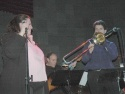 Accompanied on stage by trombone for