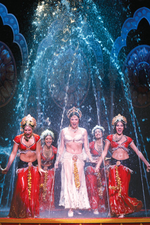 Sandra Allen and ensemble dance within an enormous fountain that drenches the stage at Bombay Dreams at Seattle's 5th Ave. Theatre