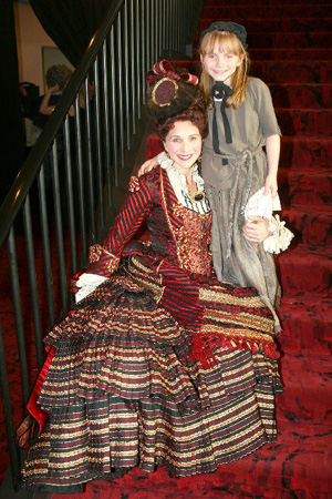 The Phantom of the Opera's Anne Runolfsson with daughter Tess Adams, who is one of the actresses playing Young Cosette in Les Miserables at Easter Bonnet Competition Day 1