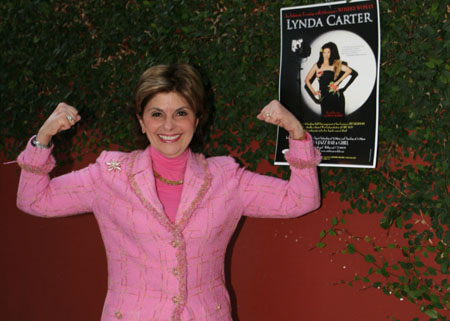Gloria Allred shows off her Wonder Woman muscles at Lynda Carter at L.A.'s Catalina Club
