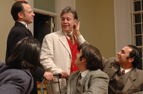 Oscar Wilde (center standing, JM Richardson) enjoys the adoration of his followers, played by cast members (l-r) Dillon Medina, Michael Zola, Tom Bentley, and Patrick Poole.